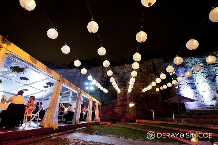 Paper lanterns strung in rows. Wedding reception styling, ideas and inspiration.  Reception Venue: The Quarry Amphitheatre Photography by DeRay & Simcoe
