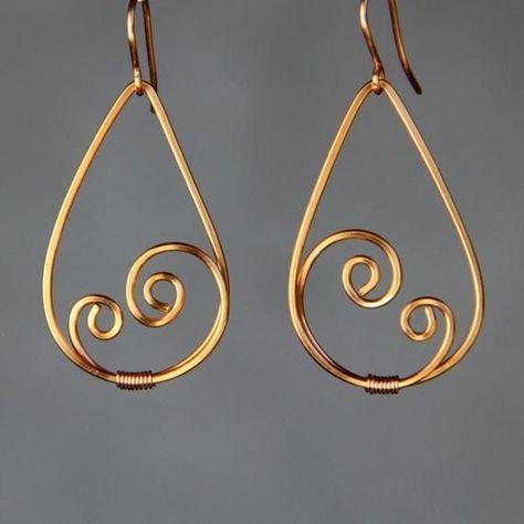 The tear drop scroll hoop earrings are handmade us…