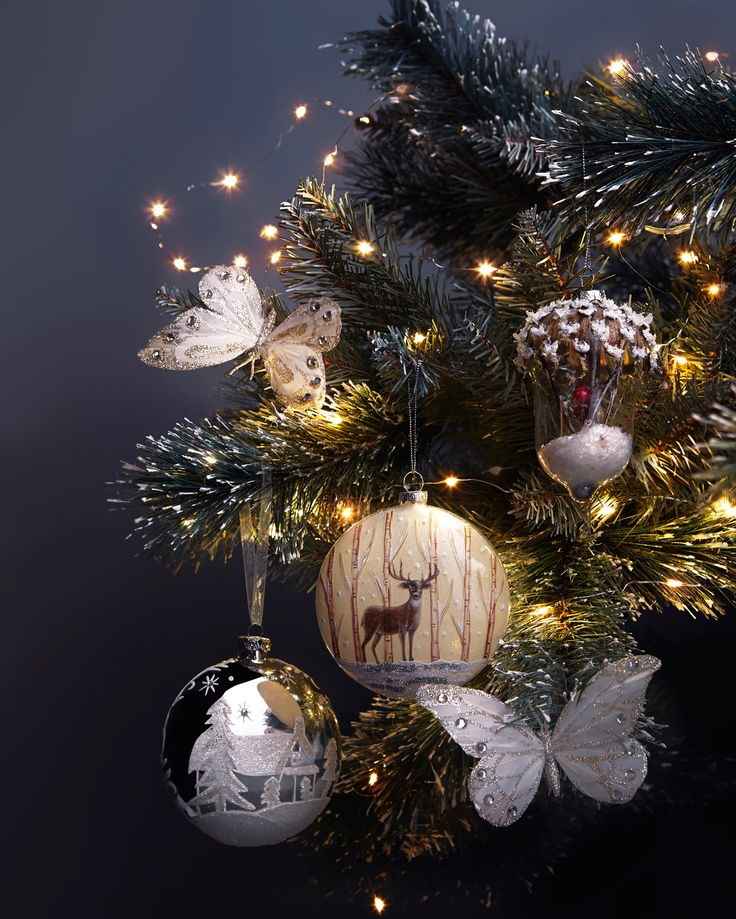Make it a fairy tale scene with ornaments that glisten and shimmer