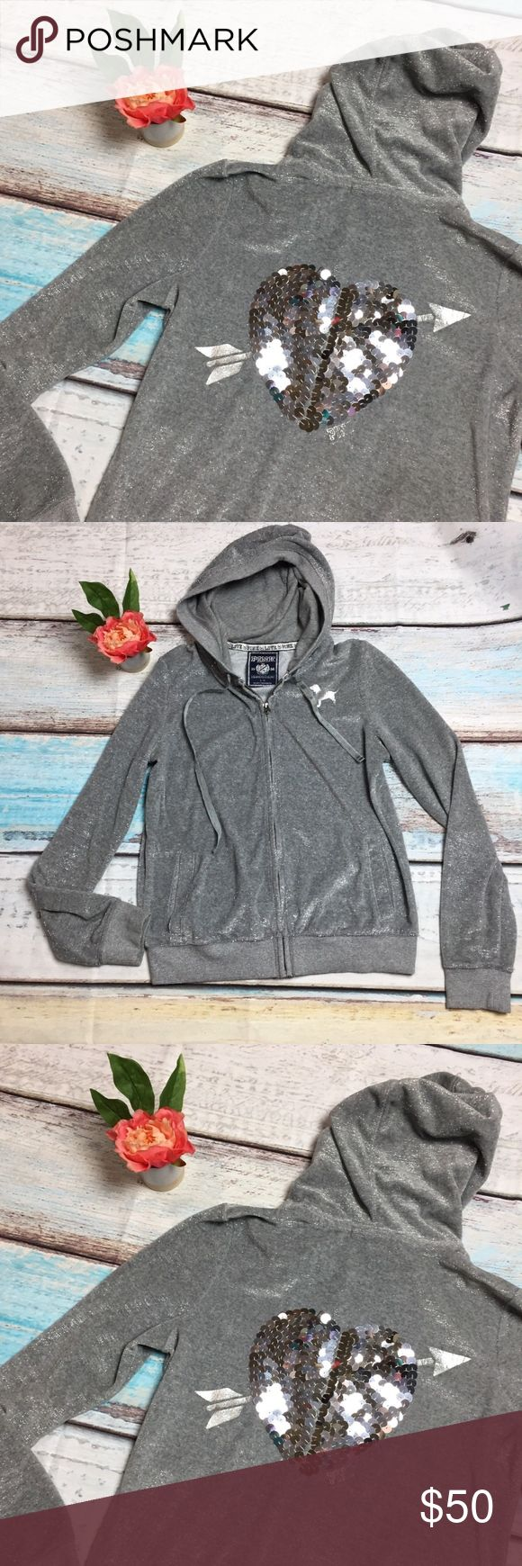 "PINK by VS Silver Sequins Heart Zip Up Hoodie Victoria's Secret PINK Size Large  Shimmery silver zip up hoodie with pockets and sequins heart on back with silver arrow detail.   Armpit to armpit: 20.5"" laying flat PINK Victoria's Secret Sweaters"
