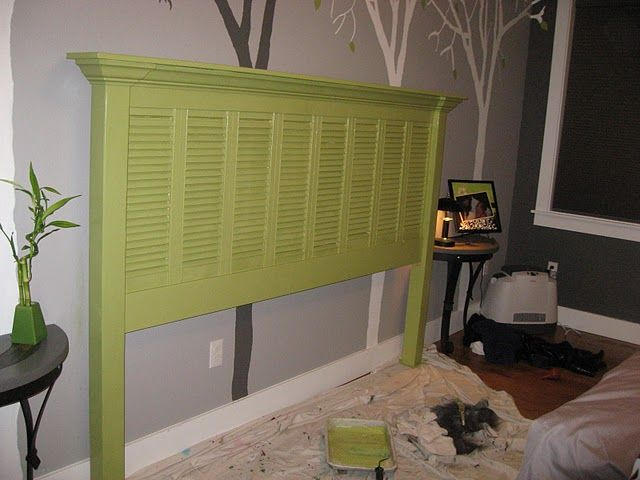headboard made from shutters.  This would look great painted white for my nautical themed bedroom