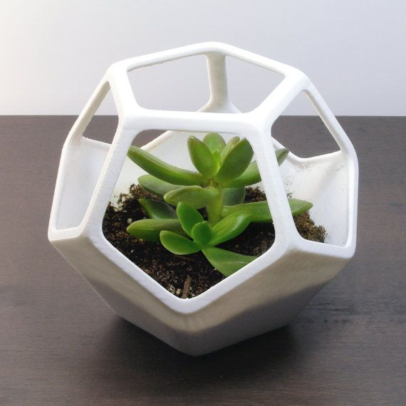 (1) 4.25 Inch Tall (11.4 cm) Dodecahedron Planter  Enjoy a dodecahedron planter made with 3D printing technology. Aside from geometric flare, the upper