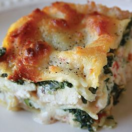 Chicken alfredo lasagna with mushrooms, onion, red peppers, zucchini, spinach and bacon.