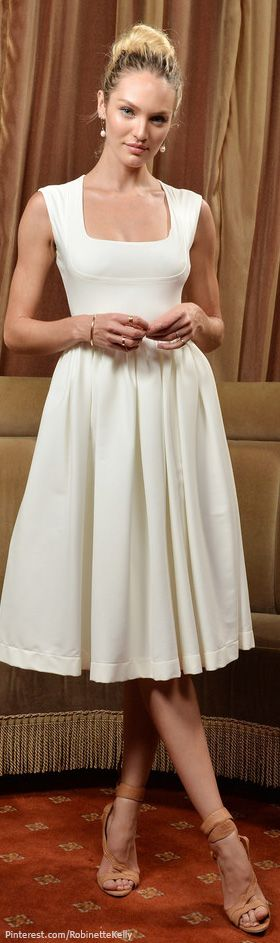 Candice Swanepoel I don't know who she is but I like this dress~  Probably not in white though...I'd stain it quickly!