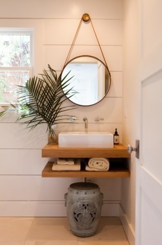 """The limestone floors are set off by the tongue and groove walls and the vintage barn wood custom made vanity."""