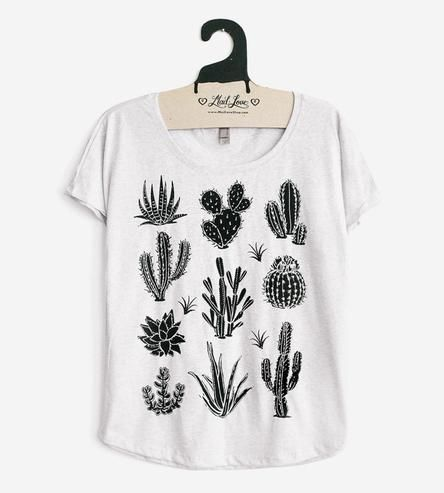 Embrace all the prickly goodness of desert plants with this cactus-covered tank top. The plant varieties range from the round barrel style cactus, to tall saguaros with fuzzy arms and spiky zebra striped leaf succulents. All nine of the cacti illustrations are printed on a softly draped dolman sleeve tee, which is lightweight for hot desert days.