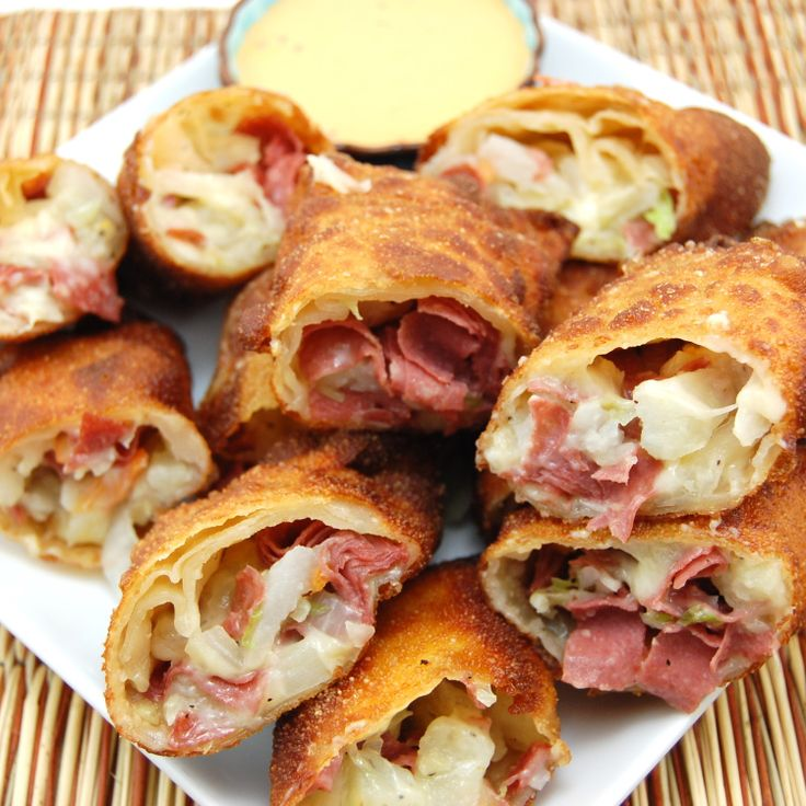 Happy St Patrick's Day!  Corned Beef and Cabbage Rolls......    To make these appetizers quick and easy, I used Boar's Head corned beef sliced fresh from the deli. Did I mention how easy these are? Sauté cabbage and onion until tender, toss in cooked potatoes and corned beef, wrap in egg roll wrappers and fry. Serve these babies with 1000 island dressing as a dipping sauce and prepared to be wowed, you might wish it was St. Patrick's Day every day!