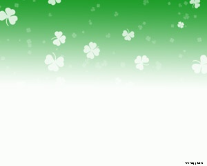 Free St. Patrick's PowerPoint template background with clovers and green theme