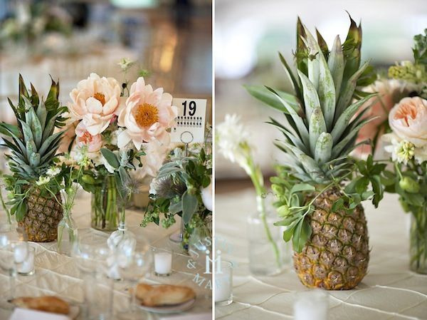 Love this. Visit pgrestaurant.com/... and let us help you plan a perfect wedding in Kauai!  Pineapple and flower centerpiece