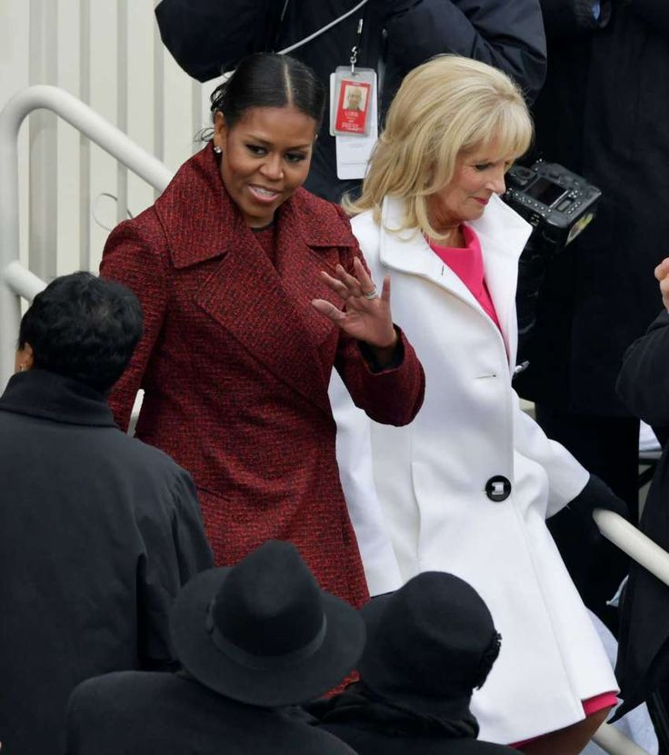 First Lady Michelle Obama, left, arrives with Vice President Joe Biden's wife, Dr. Jill Biden for the 58th Presidential Inauguration for President-elect Donald Trump at the U.S. Capitol in Washington, Friday, Jan. 20, 2017.