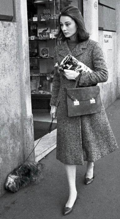 Audrey Hepburn walking her dog in Rome, 1959.