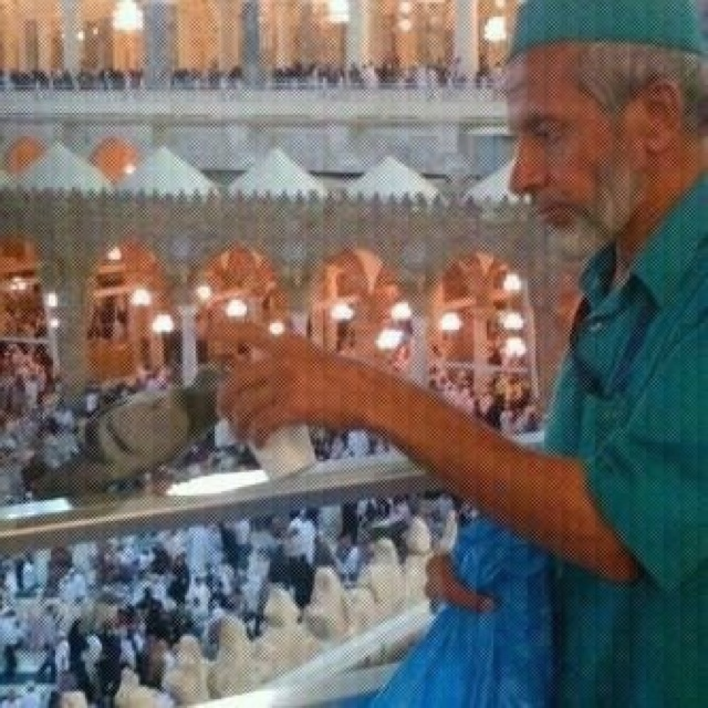Caretaker in the holy land Makkah, giving zam zam water to a thirsty pigeon. How beautiful