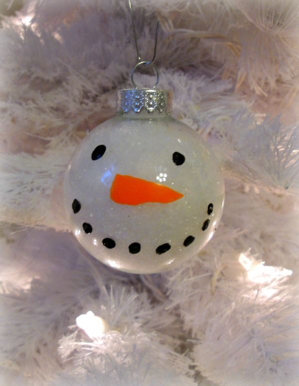 Turn a clear glass ornament into a christmas snowman for Clear ornament snowman craft