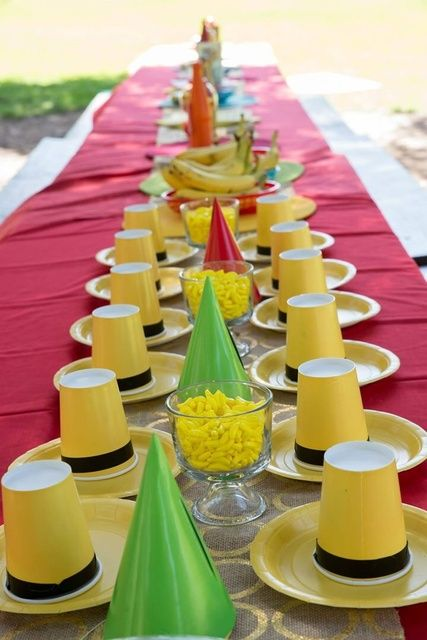 Yellow hats on a Curious George Birthday Party table!  See more party ideas at CatchMyParty.com!