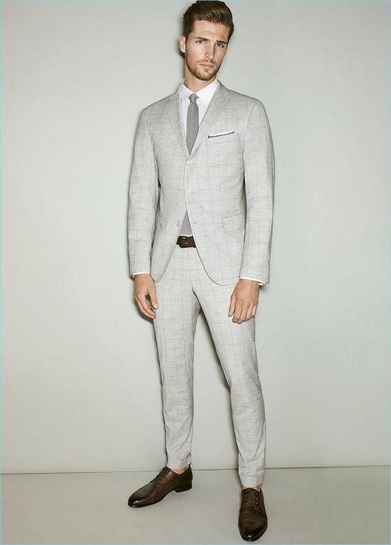 Wearing a pale grey suit, Edward Wilding stars in Joop!'s spring-summer 2017 lookbook.