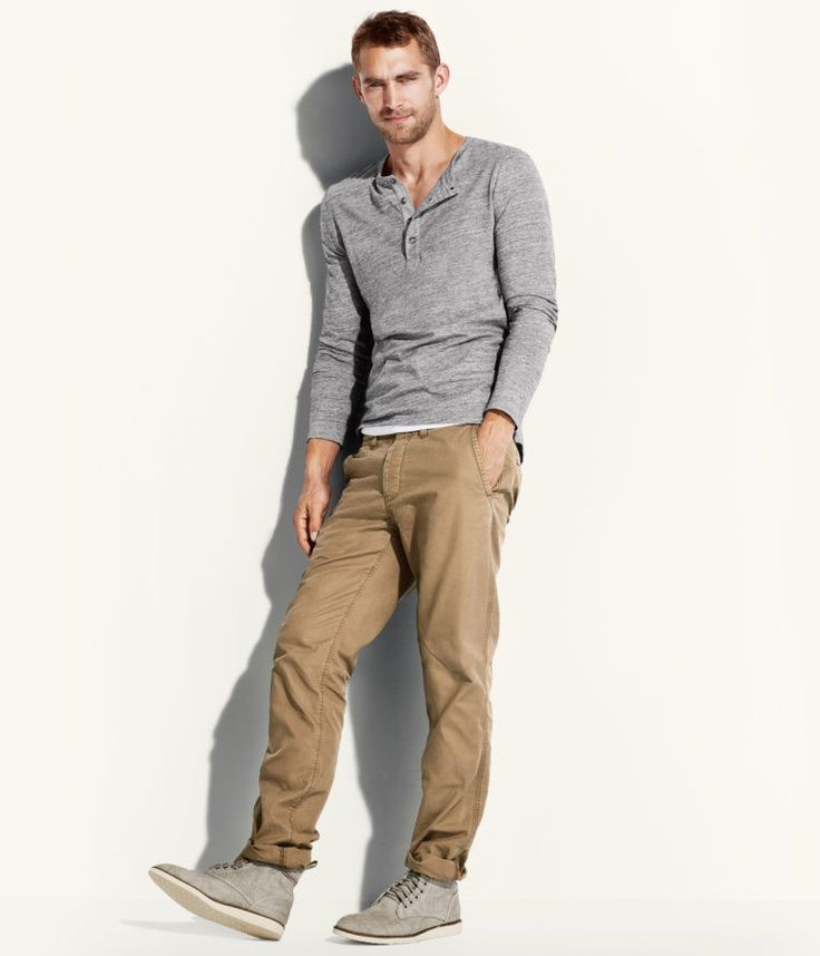 Shop this look for $31:  http://lookastic.com/men/looks/khaki-chinos-and-grey-henley-shirt-and-grey-suede-boots/1768  — Khaki Chinos  — Grey Henley Shirt  — Grey Suede Boots