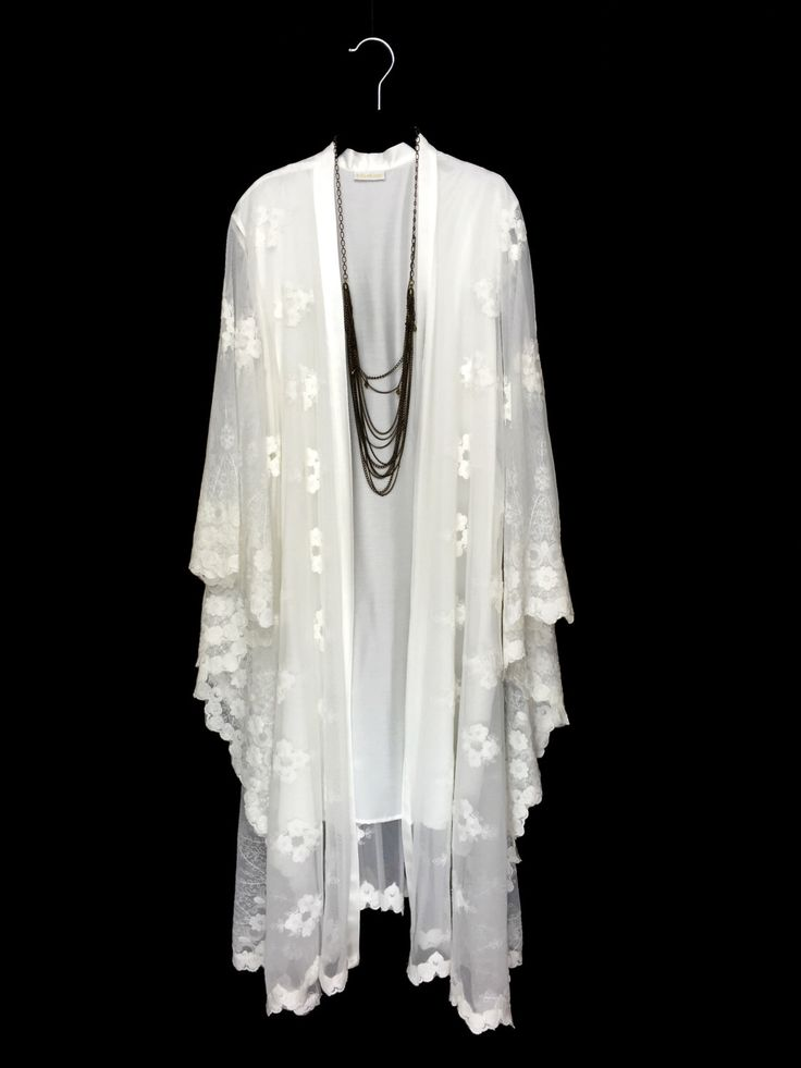 A personal favourite from my Etsy shop https://www.etsy.com/uk/listing/457256724/off-white-lace-kaftan-jacket-lined-robe