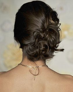 Side bun updo - would look good with veil for ceremony and then flower pin on the side for reception.