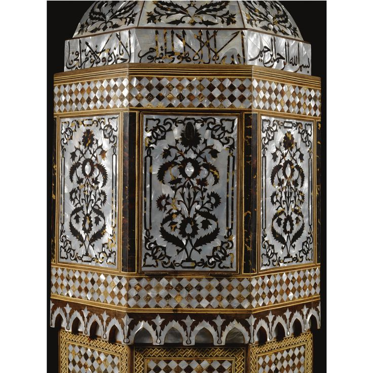 -----> the slightly broader upper section with mother-of-pearl panels inlaid with tortoiseshell floral motifs including carnations and saz leaves, bordered by tortoiseshell vertical bands, the domed section decorated ensuite, with a band of calligraphic panels 150.5cm. height 61.5cm. max.diam. Qur'an, chapter II (al-Baqarah), verse 255, ayat al-kursi, 'The Throne verse'.