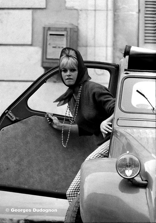 Miss Brigitte Bardot getting out of a Citroën 2CV
