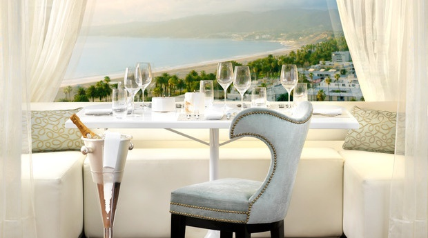 Have drinks and enjoy an awesome view of Malibu and the sunset, at the penthouse at The Huntley Hotel