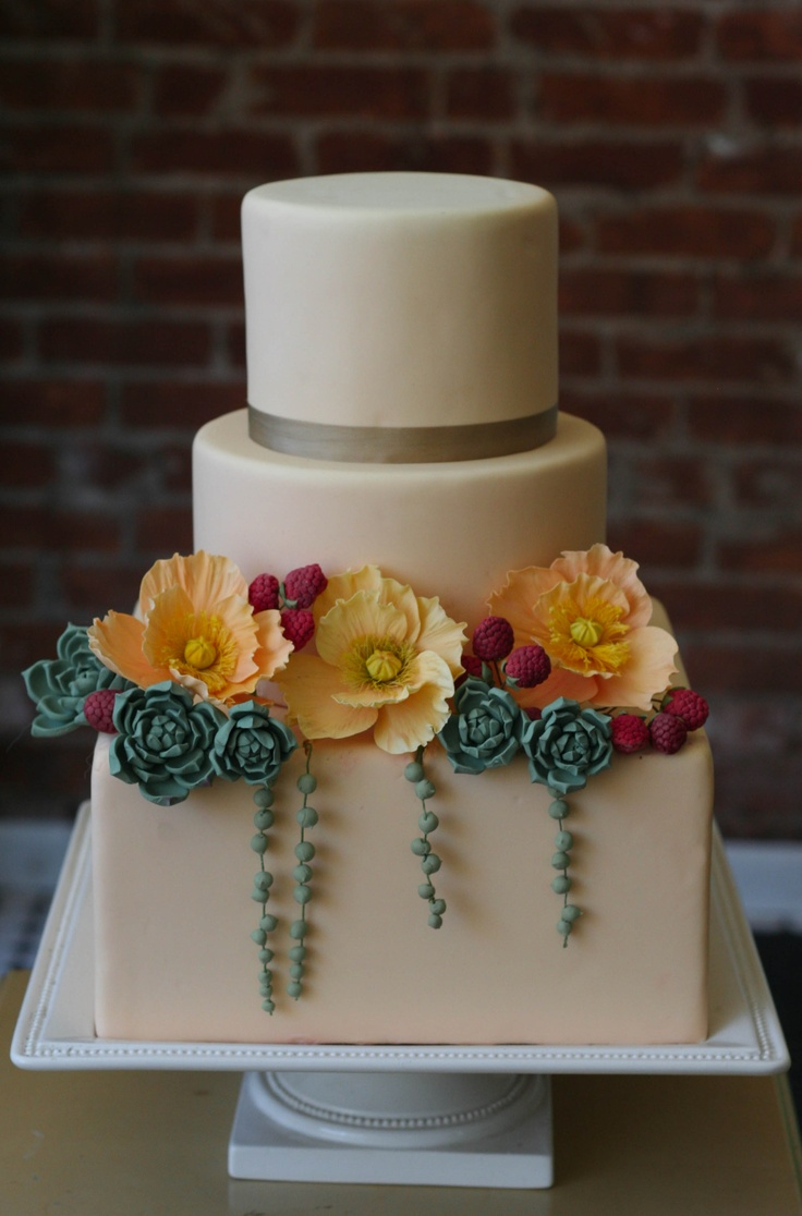 Camel colored fondant with sugar succulents, raspberries, and Icelandic poppies.
