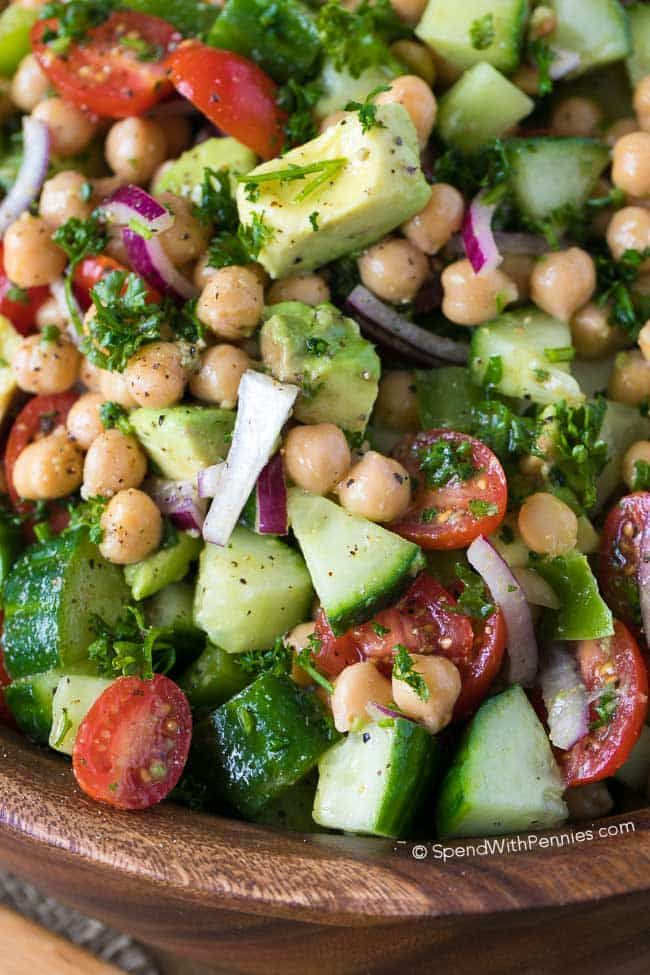 "This beautiful Chickpea Salad combines favorite fresh vegetables in one delicious bite.  Juicy tomatoes, refreshing cucumbers, creamy avocados with chickpeas all tossed in an easy homemade lemon kissed dressing.  This is the perfect make ahead dish as this salad keeps for days!"" /></div>"
