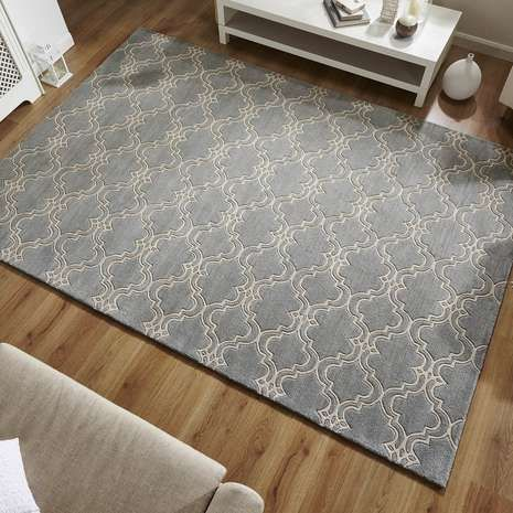 Fabricated from pure wool for warmth and softness, this hand tufted rug features a classic Moroccan inspired design in a duck egg blue tone, complete with a loop pile for high durability.