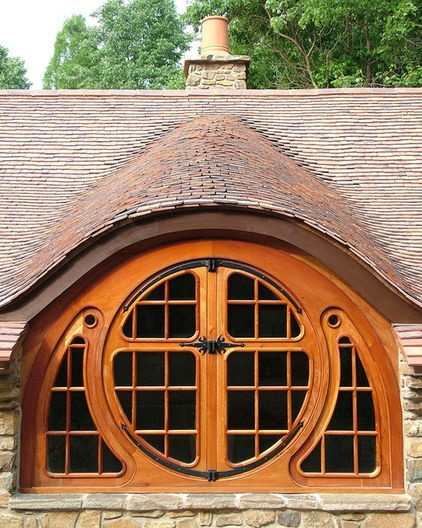 The cottage's distinctive butterfly window, made from mahogany and so named because it looks like the wings of a butterfly when open, stemmed from Tolkien's sketches, as well as his descriptions of hobbits preferring windows that showcase views of the woods. The semicircular halves of the window open from a center hinge.