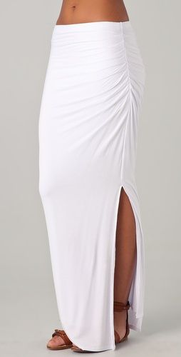 Jersey maxi skirt features asymmetrical ruching and a slit at the side. Covered elastic waistband. Double-layered.