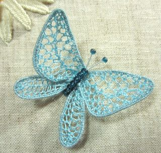 Lacey embroidered butterfly and she shows dragonflies too. First needle-lace I completed was a butterfly. So much variety you can create in those wings.