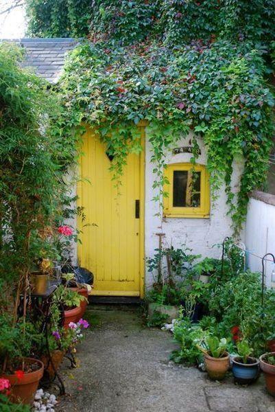 Love the yellow door and window.