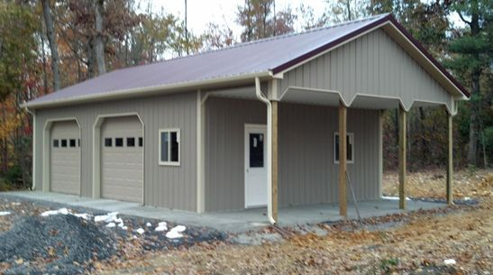 Superior Buildings built this 24x32x10 pole building residential garage with a porch with dutch corners in Pineville, VA.