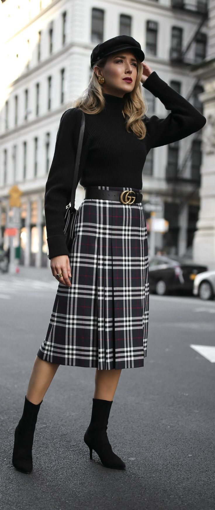 Click for outfit details!  Pleated plaid midi skirt, black puffed-shoulder turtleneck, black sock boots, baker boy cap and black leather waist belt {Burberry, Anthropologie, Stuart Weitzman, Gucci, M2Malletier, Brixton, classic style, fall style, classy d