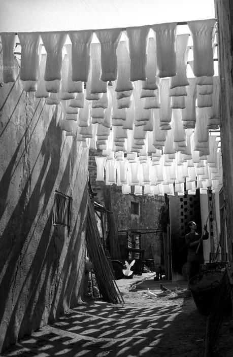 GEORGE RODGER TUNISIA. Medina of Tunis. Skeins of cotton hanging to dry in dyers souk. 1958