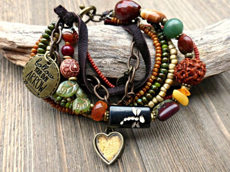 Follow your arrow.  Bronze metal, glass, stone, amber, leather, chain beaded jewelry.