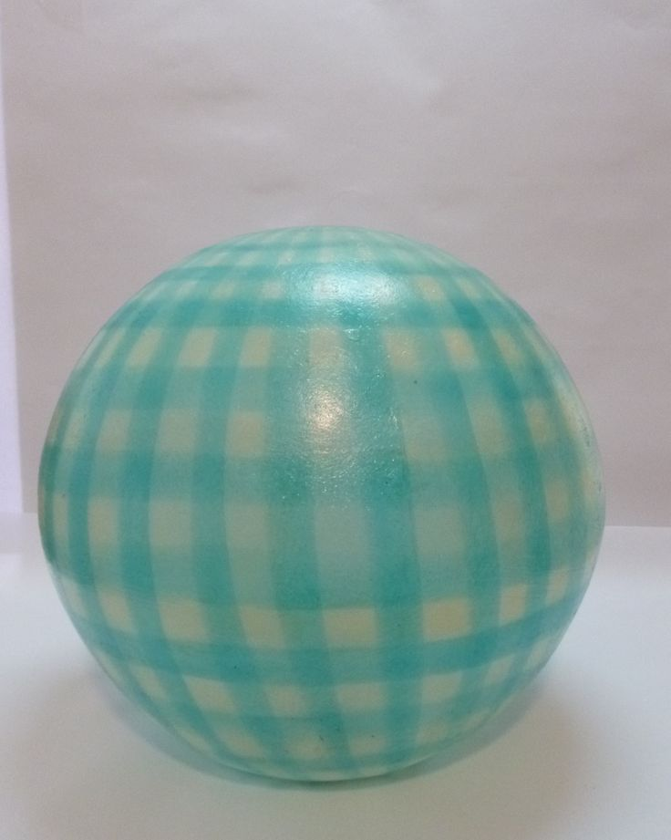 The ball's background colour is natural white and its check design comes in three colours: light pink, light blue and light green. The check design is horizontal for the Grass Green and Minty Blue balls They come complete with an E14 bulb holder and you can use as much wattage as you need. For more pics, pleace cut and paste the following links:http://gshopspot.gr/product.php?product_id=444 (for the Minty Blue) http://gshopspot.gr/product.php?product_id=445 (for the Grass Green)