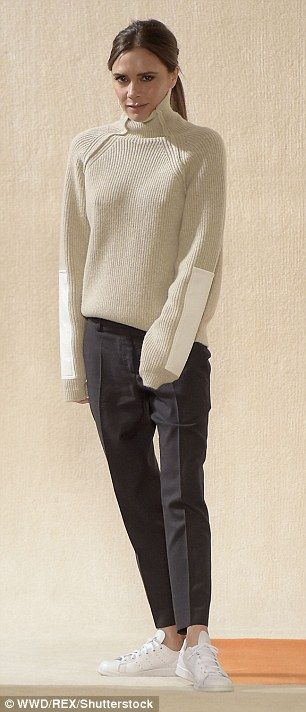 Keeping things simple: She wore a thick cream jumper with a pair of navy trousers which she teamed with a pair of simple white Adidas trainers