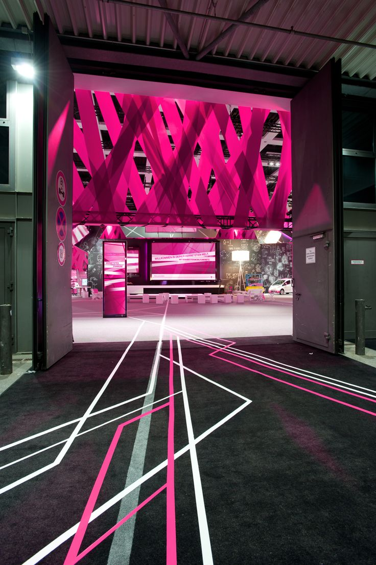 - Exhibits that use unusual material choices - Deutsche Telekom at IFA, 2012 (the world's leading trade show for consumer electronics and homeappliances) - I found the creativity in material choice inspiring; tape is often used as a guide but is rarely used as a material for an exhibit.