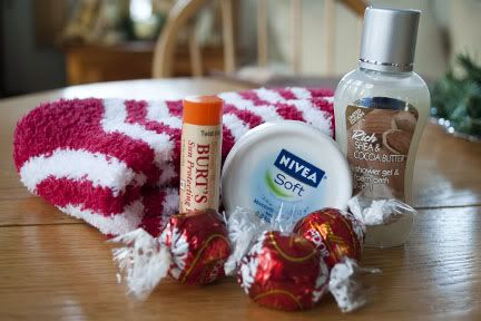 christmas gift: pampering in a jar - warm fuzzy socks, lip balm, hand lotion , bubble bath, bath salts and some chocolates. add a bit of ribbon and a tag.