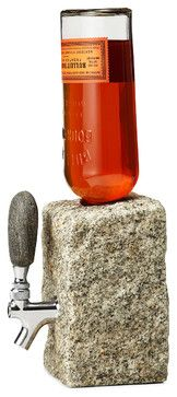 """Our hottest product, the one and only Booze dispenser. Why not serve your drinks """"on the rocks""""? You may not be able to get water from a stone, but you can tap your favorite drinks. Cut from cobbled granite and completed with a 100% stainless steel valve, each with a one of a kind beach stone tap handle, the rock drink dispenser makes a unique addition to your parties, events and home decor."""