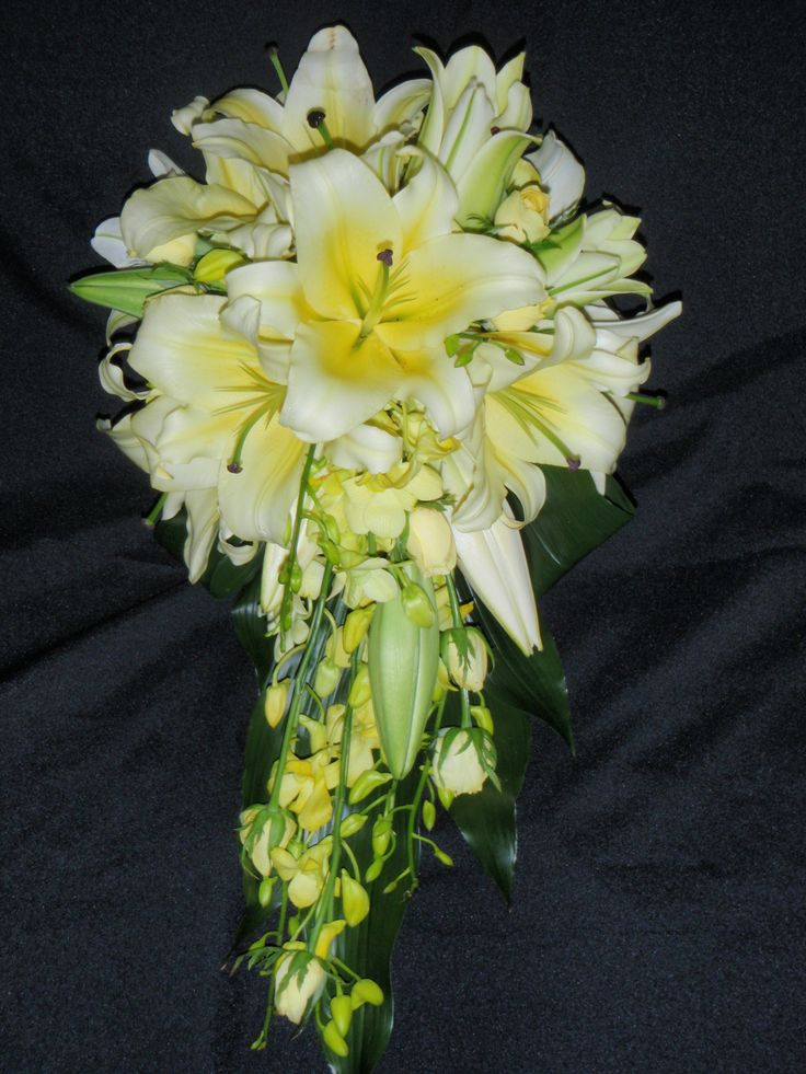 Bright Wedding Bouquet with yellow Oriental Lily, Yellow Roses and yellow Dendrobium Orchid. Created y Poppies and Peas Floral Design.