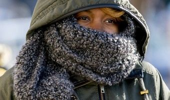woman bundled up cold ap