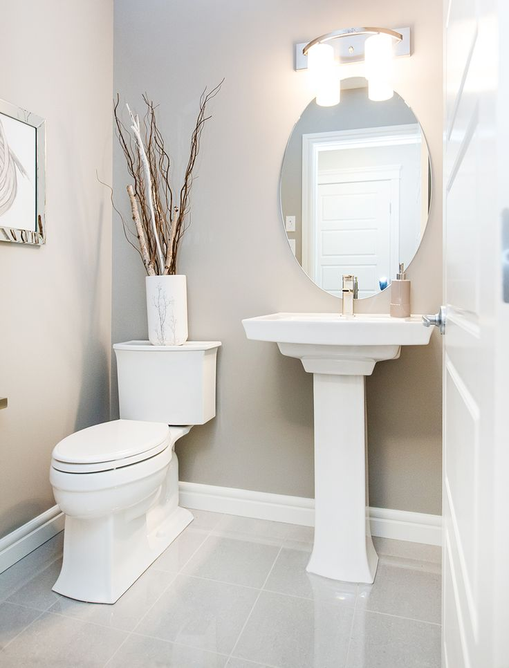 Love this adorable half bathroom; the #pedestal sink is beautiful.