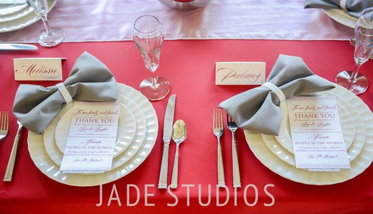 Modern red wedding decor with touches of pewter