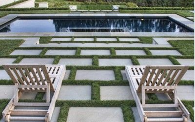 #GranitePaving used as stepping stones around a pool area. The space in between the #GranitePavers breaks up the pattern, creating a irregular, yet effective look