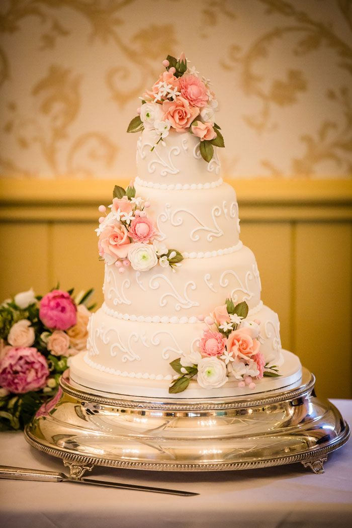Wedding of the Week: Hannah Richbell and William Goldsmith | Suffolk church wedding | Classic four tier wedding cake with sugar flowers | weddingsite.co.uk