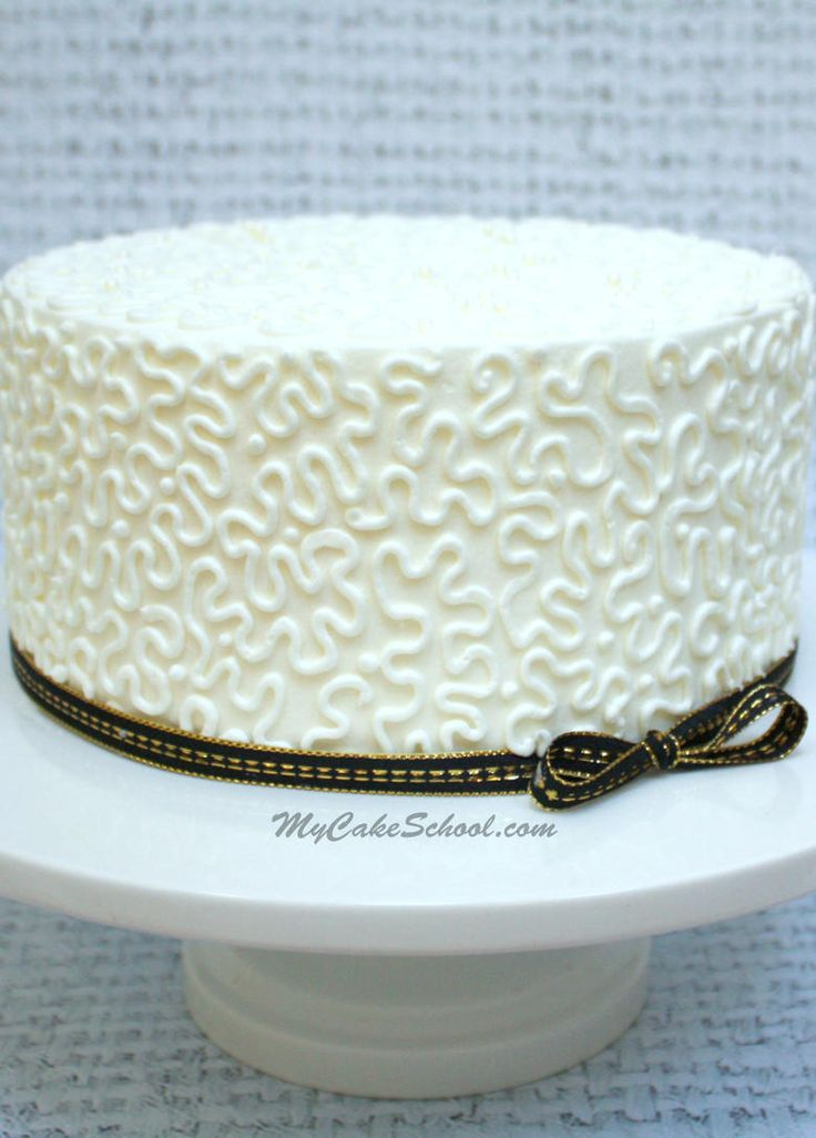 Learn the elegant cake decorating technique of piped cornelli lace in this quick cake decorating video tutorial!