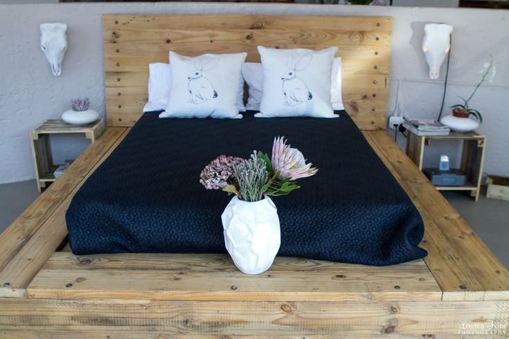 Wooden Bed base with navy and white linen