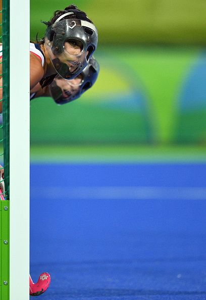 #TOPSHOT Britain's Sam Quek defends her team's goal during the women's quarterfinal field hockey Britain vs Spain match of the Rio 2016 Olympics Games...